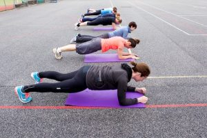 Bootcamp / outdoor fitness class plank