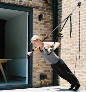 Personal trainer and outdoor fitness instructor Bronwen Wright demonstrates tricep exercises